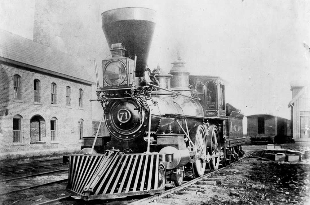 "Photo by Goerge Rockwood of an Atlantic & Great Western Railroad's  65,000 pound 4-4-0 locomotive. It had 66 "" drivers and a 6ft. gauge. c1865"