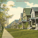 Vintage view of Baird Ave, Barberton, Ohio. The colonial style houses shown on this historic postcard are typical of the homes build throughout the crowded residential streets of Barberton.